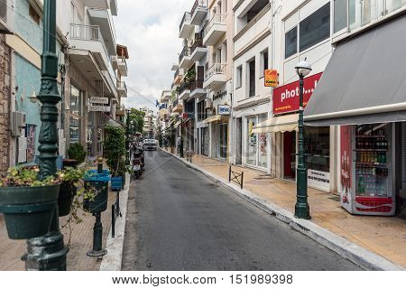 SITIA, CRETE, GREECE - JUNE 2016: Old street of Sitia town with different shops and cafes on Crete island