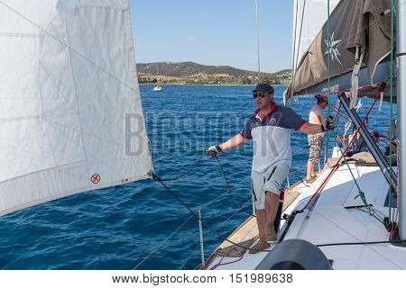 HYDRA, GREECE - SEP 28, 2016: Sailors participate in sailing regatta 16th Ellada Autumn 2016 among Greek island group in the Aegean Sea, in Cyclades and Saronic Gulf.