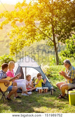 Happy family in the countryside together on a sunny day