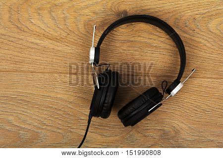 Pair Of Headphones On A Rustic Wooden Surface