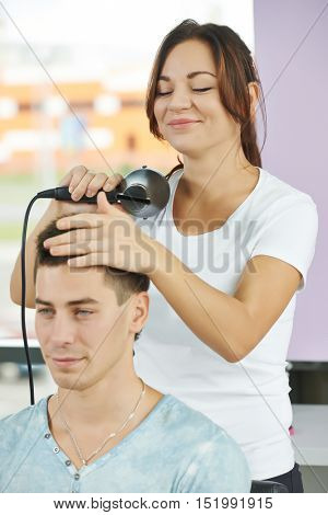 hairdresser at work making haircut