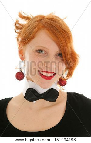 Young woman portrait with Christmas balls in ears