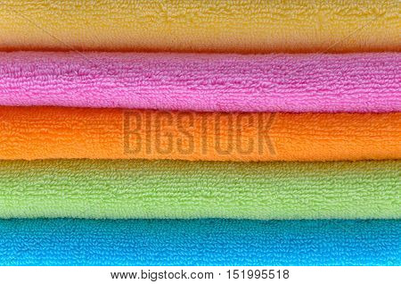 colorful bath towels stacked photographed at close range