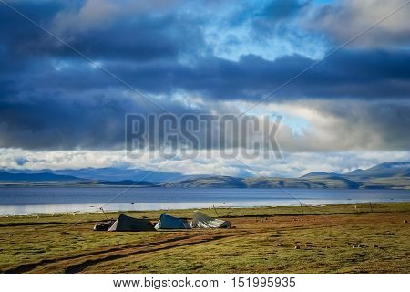 Three tents pitched on the shore of Lake Manasarovar in Central Tibet