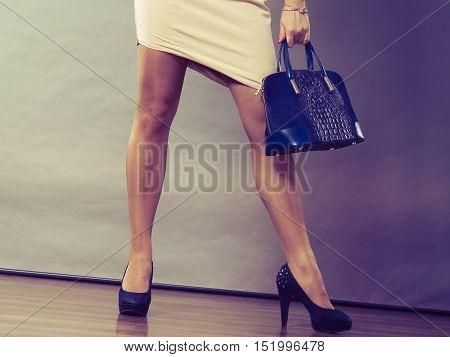 Woman With Black Handbag.