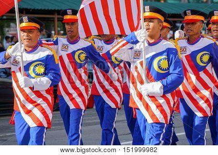 Kota Kinabalu,Sabah-Aug 31,2016:Malaysian wearing Malaysian flag themed uniform costume to celebrating the Malaysia National Day at Kota Kinabalu,Sabah,Borneo,Malaysia on 31st Aug 2016.
