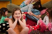 foto of mayhem  - Girl overwhelmed with silly friends at a sleepover - JPG