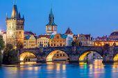 Famous Prague Landmarks - towers and bridge at night time with city illuminated, Prague, Czech, Euro poster