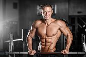 Strong Athletic Man Fitness Model Showing Six Pack Abs poster