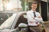 Businessman Posing With His Car poster