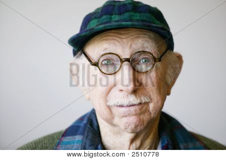 Senior Man In A Hat And Glasses