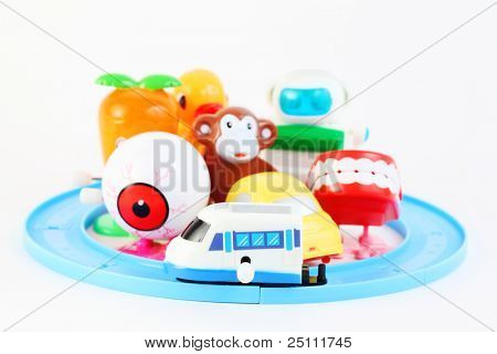 group of eight little bright clockwork toys on white background