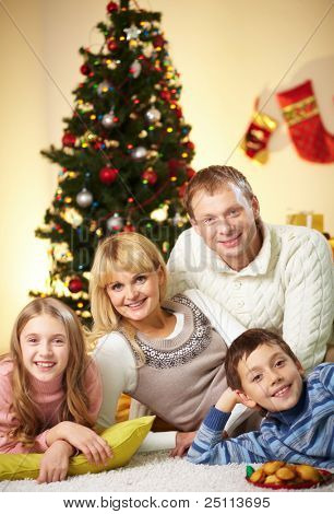 Portrait of four happy family members looking at camera with smiles