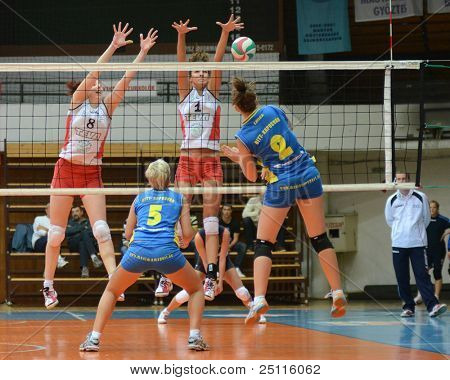 KAPOSVAR, HUNGARY - OCTOBER 21: Zsanett Pinter (blue 2) in action at a Hungarian NB I. League volleyball game Kaposvar (blue) vs Godollo (white), October 21, 2011 in Kaposvar, Hungary.