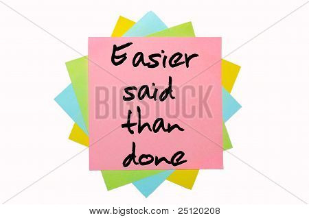 "Proverb ""easier Said Than Done"" Written On Bunch Of Sticky Notes"