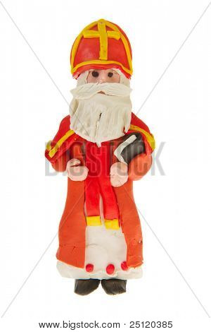 selfmade Dutch Sinterklaas from clay isolated over white background