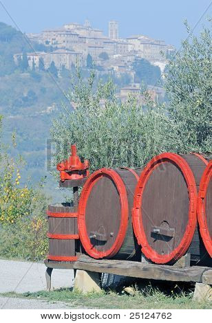 Wine barrels and the hilltop town of Montepulciano, Italy