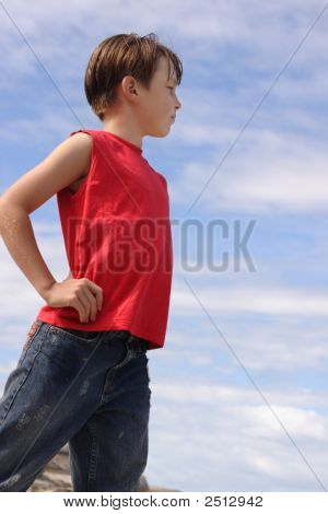 Boy Against Blue Cloudy Sky