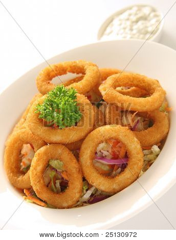 Onion Rings served on a bed of coleslaw salad and tartar sauce