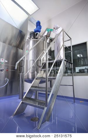 an operator working in manufacturing facility in pharmaceutical factory