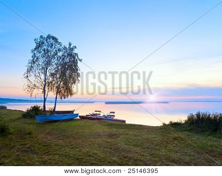 Sunset With Boats Near The Summer Lake Shore