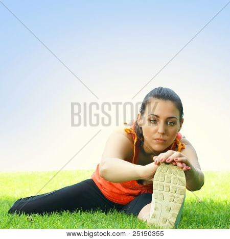 Fitness Girl Stretching Outdoors