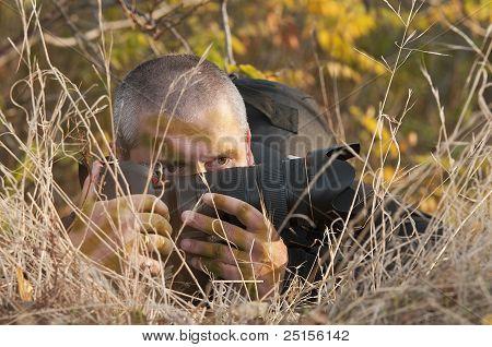 Camouflaged Photographer.