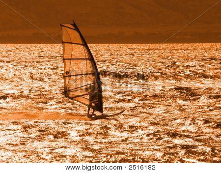 Young Windsurfer Alone At Sunset