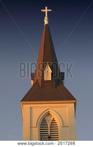 Church Steeple In Setting Sunlight