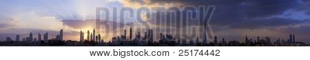 High resolution panoramic view of dubai buildings including burj khalifa with beautiful clouds and sunrise background.