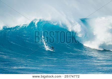 MAUI, HI - MARCH 13: Professional surfer Hanu Sandru rides a giant wave at the legendary big wave surf break known as