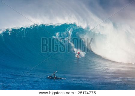 MAUI, HI - MARCHh 13: Professional surfer Yuri Soledade rides a giant wave at the legendary big wave surf break known as