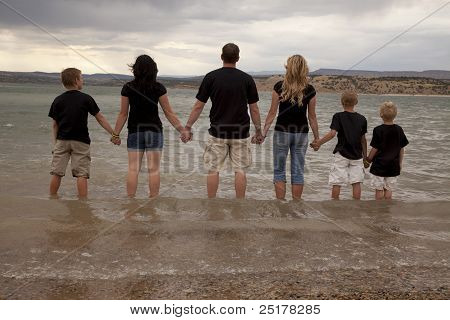 Family Hold Hands Lake