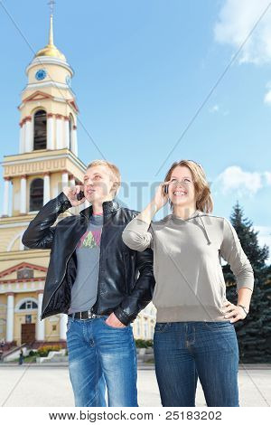 Young couple speaking on mobile phone