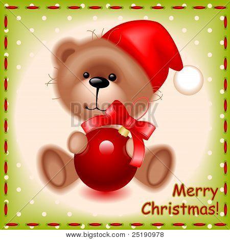 teddy toy bear with a Christmas ball
