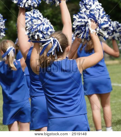 Cheerleaders Cheering During Football Game