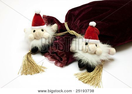Santa Claus toy and fancy luxury gift bag