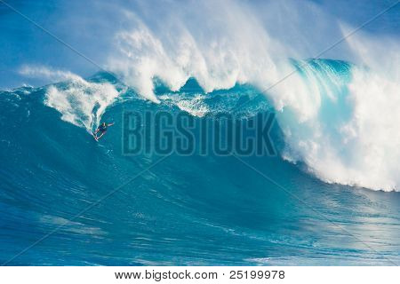 MAUI, HI - MARCH 13: Professional surfer Laird Hamilton rides a giant wave at the legendary big wave surf break known as