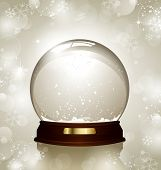 pic of insert  - empty snowglobe against a bright defocused background with glittering lights and snowflakes  - JPG