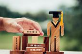 Back To School Concept, People Sign Wood With Graduation Celebrating Cap On Wooden Square Blocks Tow poster