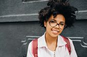 Portrait Of Cheerful Young African American Student Female Wearing Eyeglasses Getting Ready To Go To poster