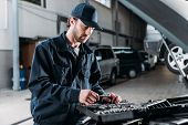 Mechanic With Tool Case In Auto Repair Shop poster