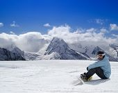 Snowboarder Resting On The Ski Slope