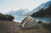 Camping Tent In Campground At National Park. Tourists Camped In The Woods On The Shore Of The Lake O poster