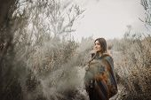 Beautiful hipster traveler girl in gypsy look in desert nature.  Artistic photo of young hipster tra poster