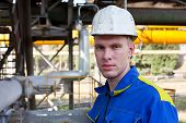 Young Handsome Man Constructor In White Hardhat And Blue Uniform