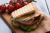 Sandwich with grilled chicken steak meat, tomato and lettuce poster
