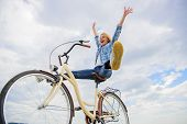 Woman Feels Happy While Enjoy Cycling. Girl Rides Bicycle Sky Background. How Cycling Changes Your L poster