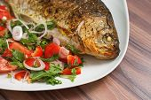 Fish Dish. Roasted Crucian Carp On White Plate With Fresh Mix Vegetable On Table. Close-up Fried Car poster