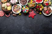 Colorful sweets. Lollipops, macaroons, marshmallow, marmalade and candies. Top view with space for y poster